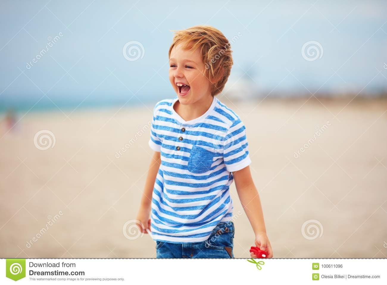 Download Young Delighted Boy, Kid Playing With A Toy Propeller, Having Fun On Summer Beach Stock Photo - Image of airscrew, life: 100611096