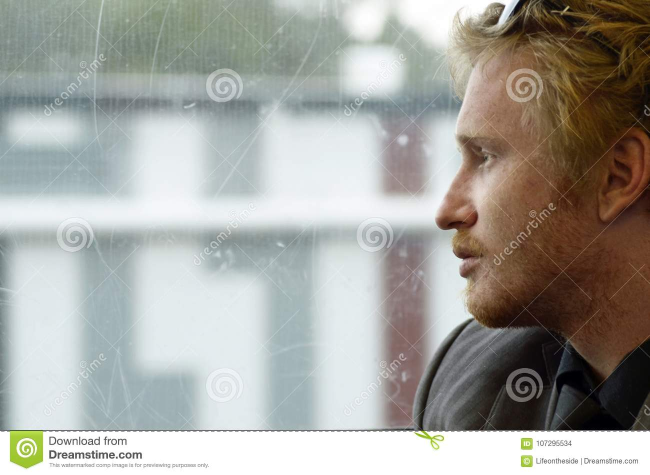 Young depressed man reflecting on life journey soul searching