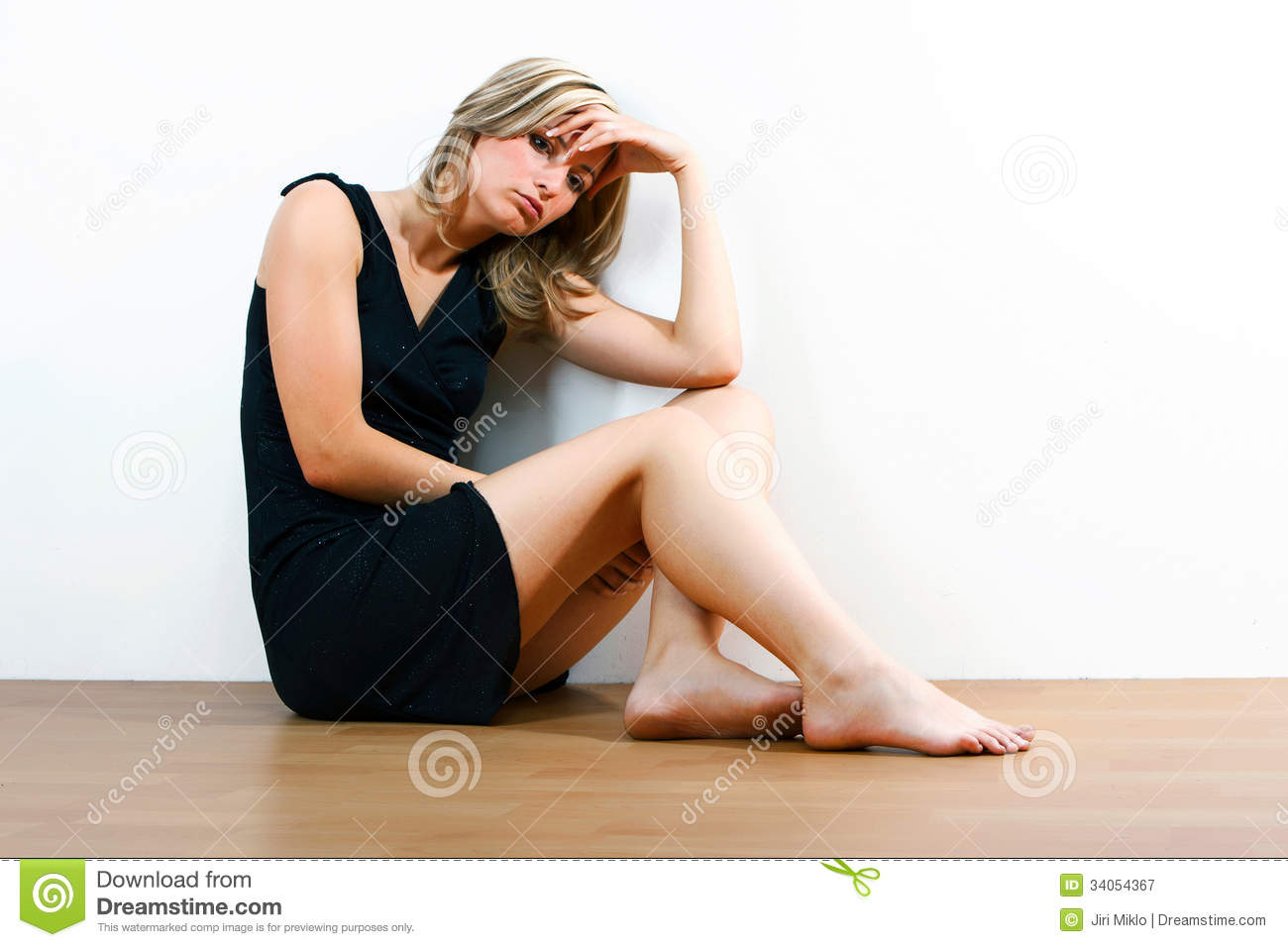 young depressed woman sitting on floor royalty free stock photography image 34054367. Black Bedroom Furniture Sets. Home Design Ideas