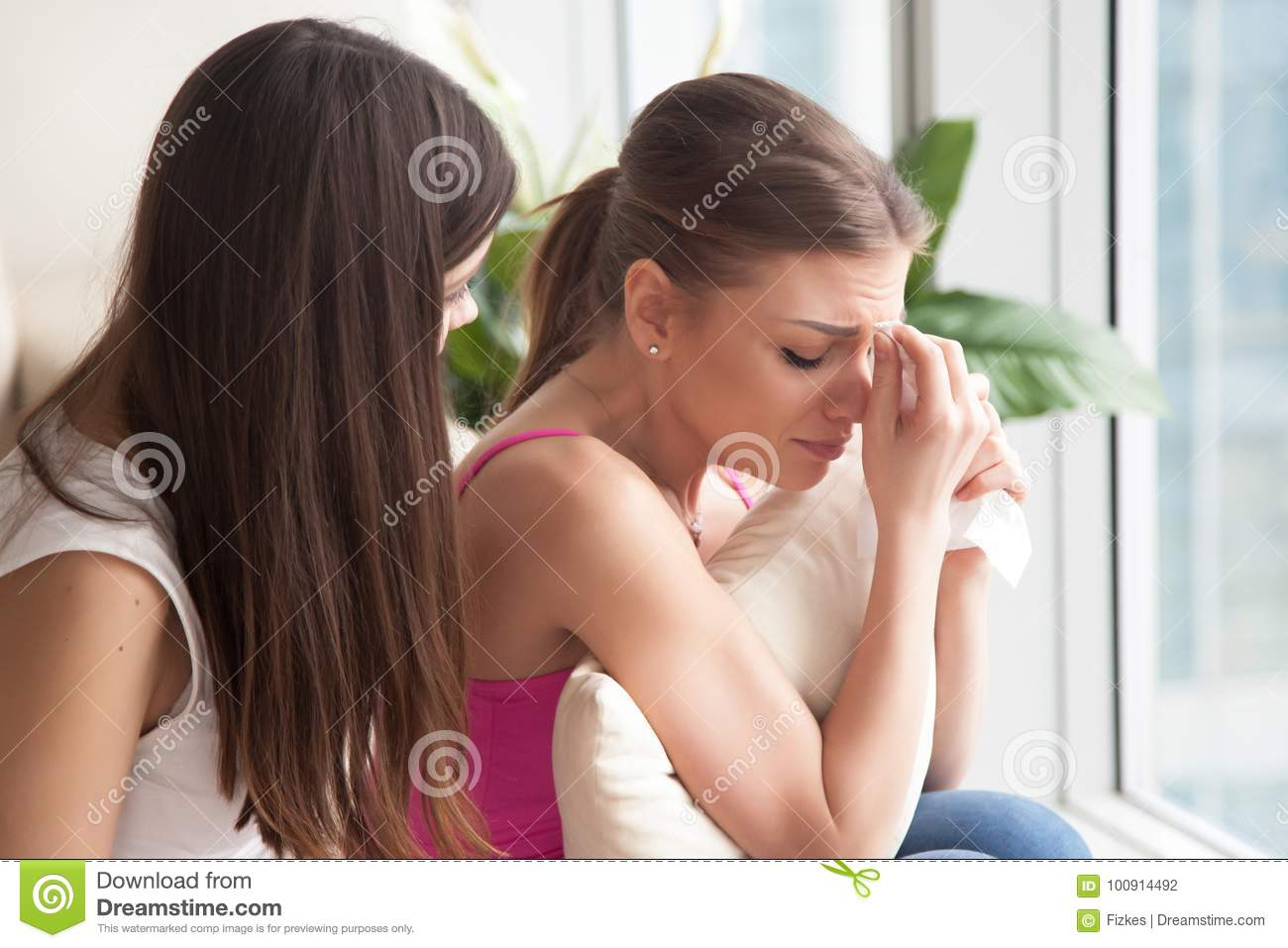 Young Depressed Young Woman Crying, Girlfriend Supporting Her Wi
