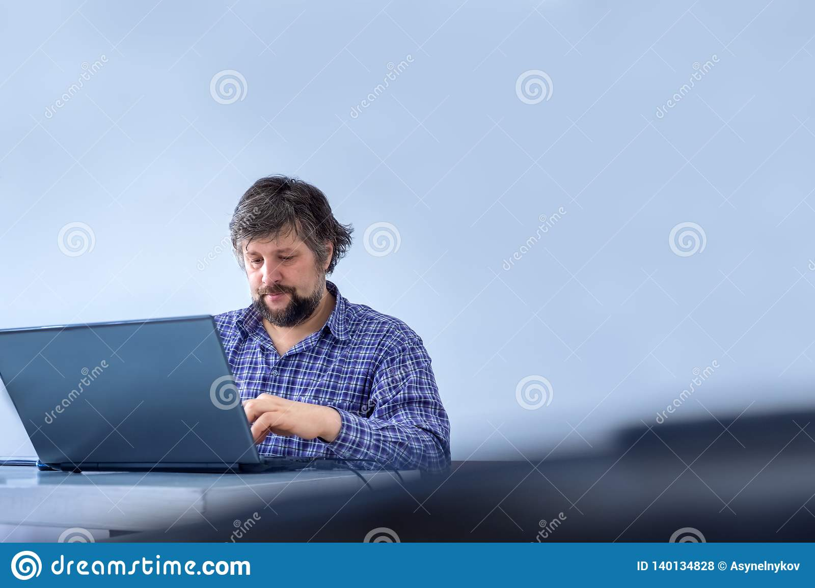 Businessman dressed casually. Office worker typing on laptop. Successful businessman working on laptop, computer