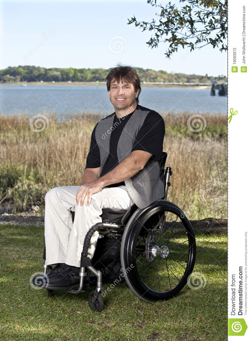 Young disabled man in wheelchair stock photography image 19093972