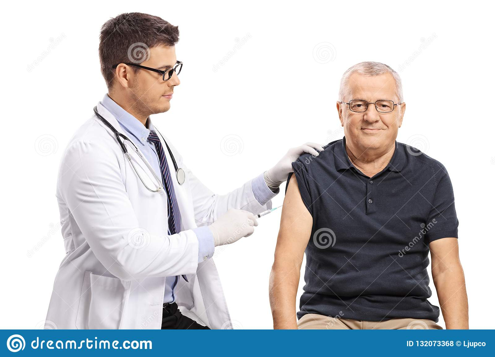 Young doctor giving a shot to a mature man