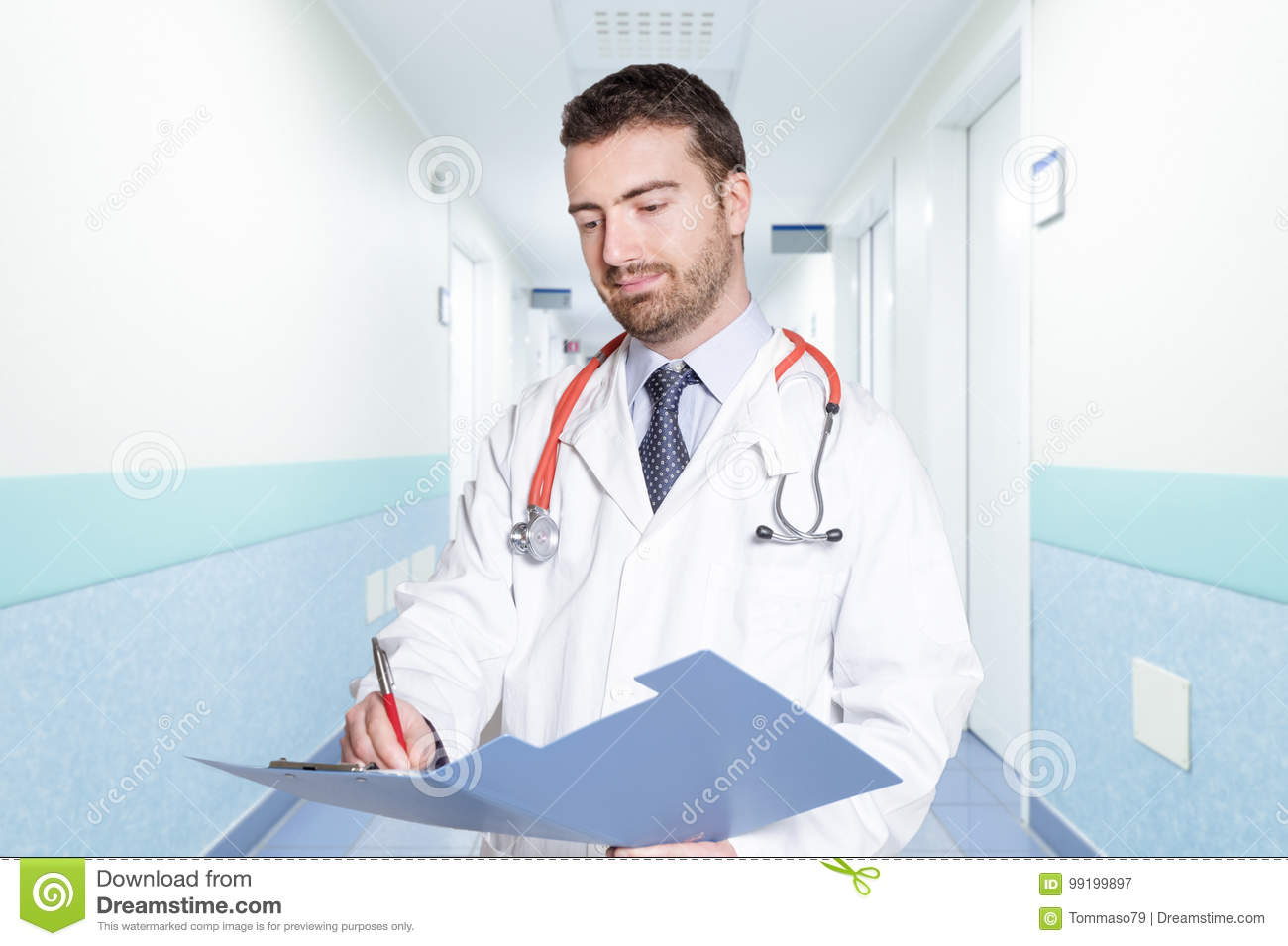 Young doctor portrait on hospital corridor background