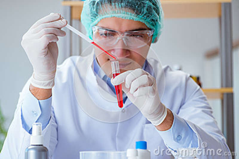 The Young Doctor Working On Blood Test In Lab Hospital Stock Image