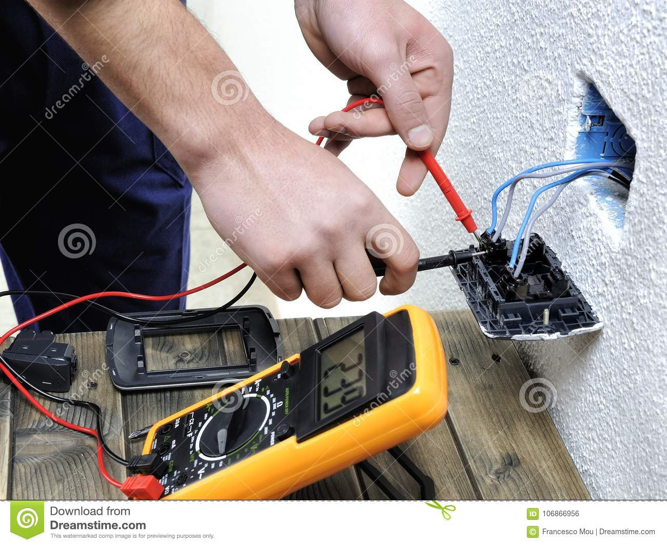 Young Electrician Working In A Residential Electrical Installati ...