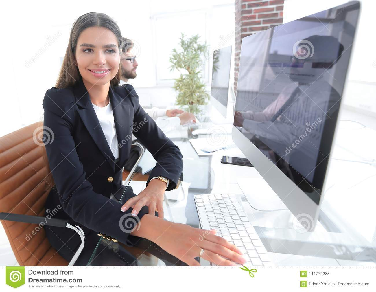 Young employee sitting at a Desk