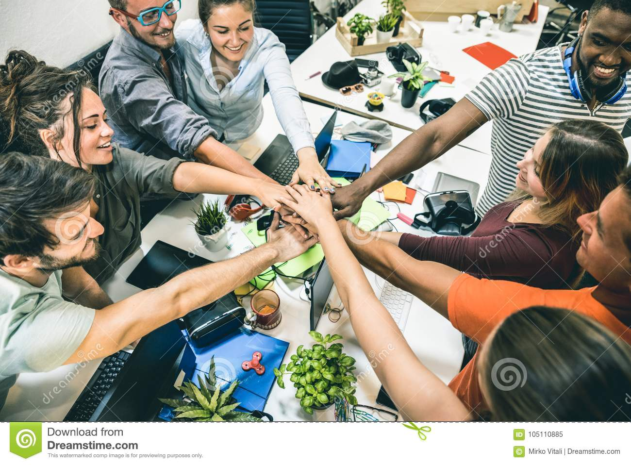 Download Young Employee Startup Workers Group Stacking Hands At Start Up Office Stock Image - Image of project, partnership: 105110885