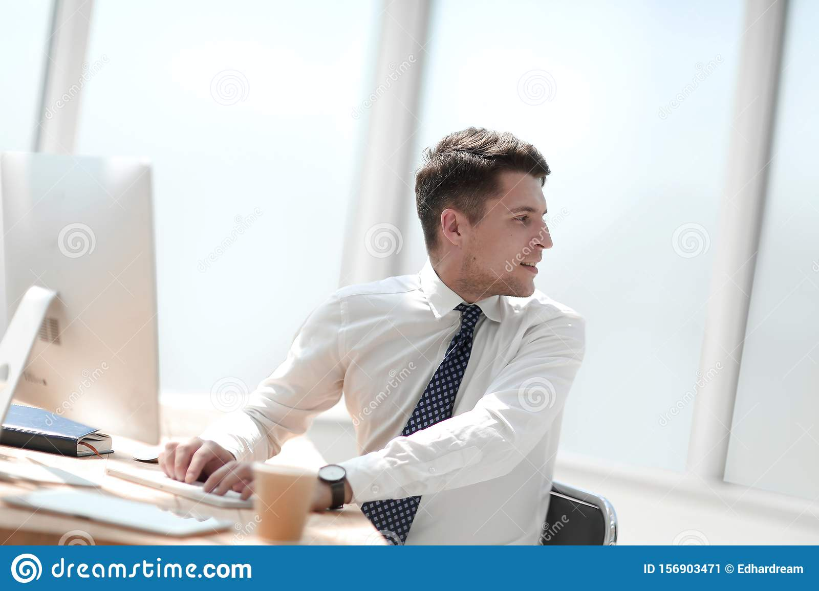 Young employee in the workplace in the office