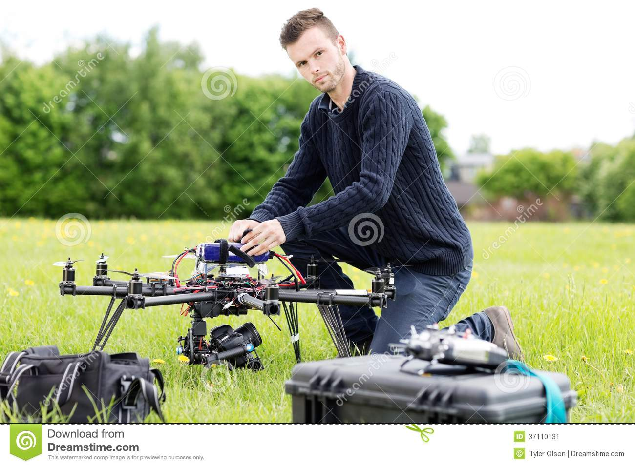 Young Engineer Preparing Spy Drone in Park