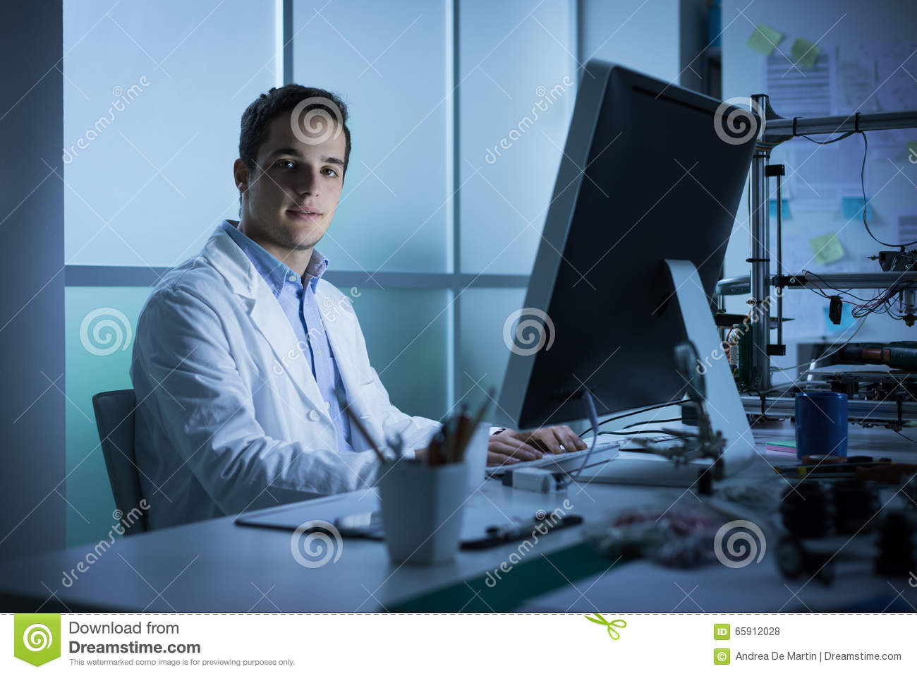 Young engineer working at desk