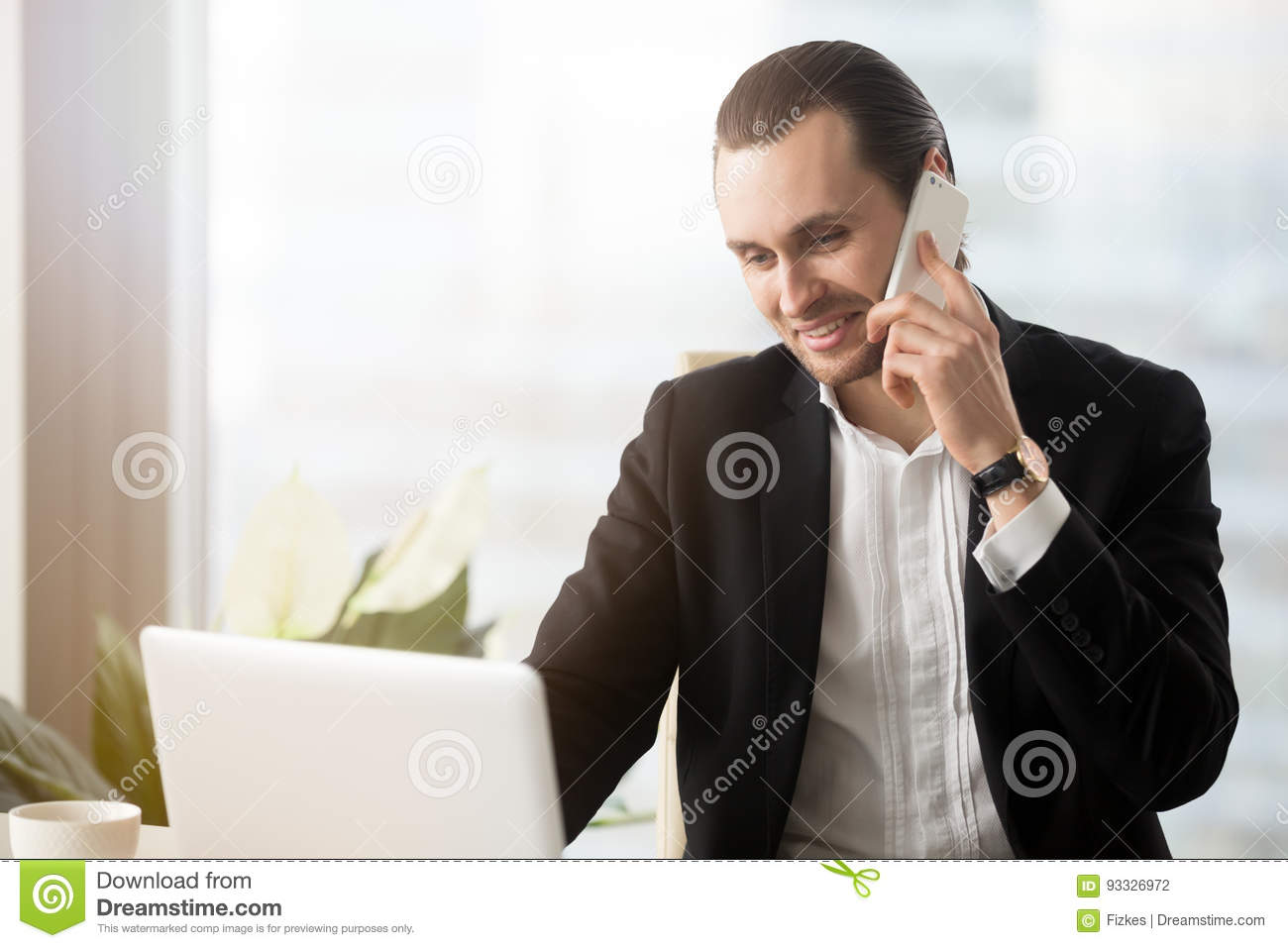 Young Entrepreneur Answers The Call At Workplace Stock Photo - Image