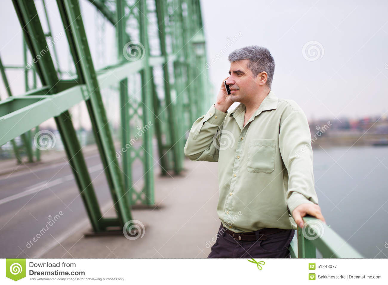 Young Entrepreneur Calling At Bridge Stock Photo - Image: 51243077