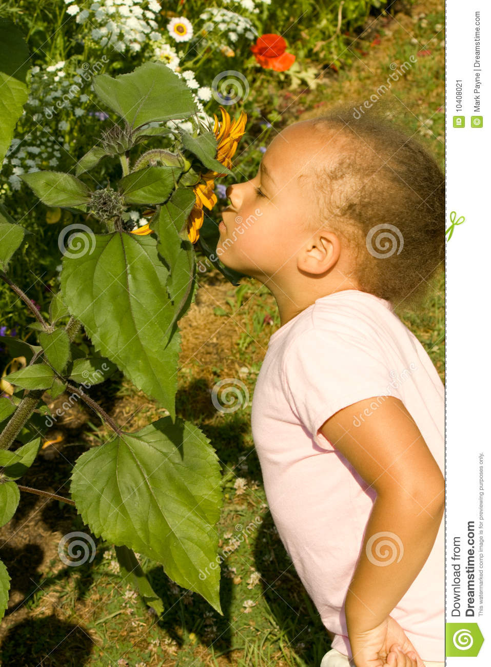 Young Ethnic Girl smelling the flowers