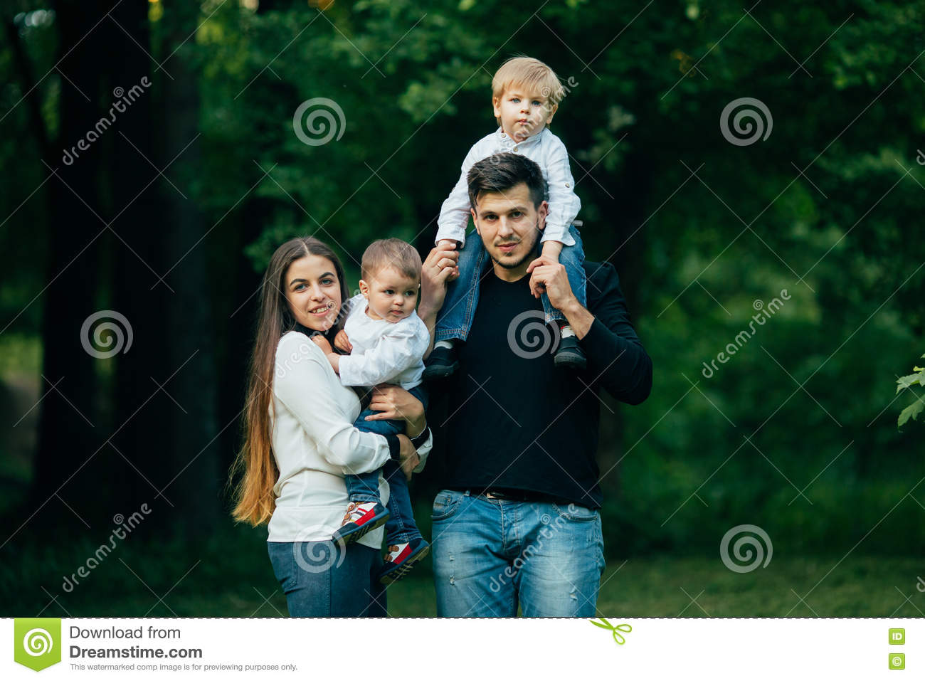 Young family with children, Happy father, mother and two sons spending time