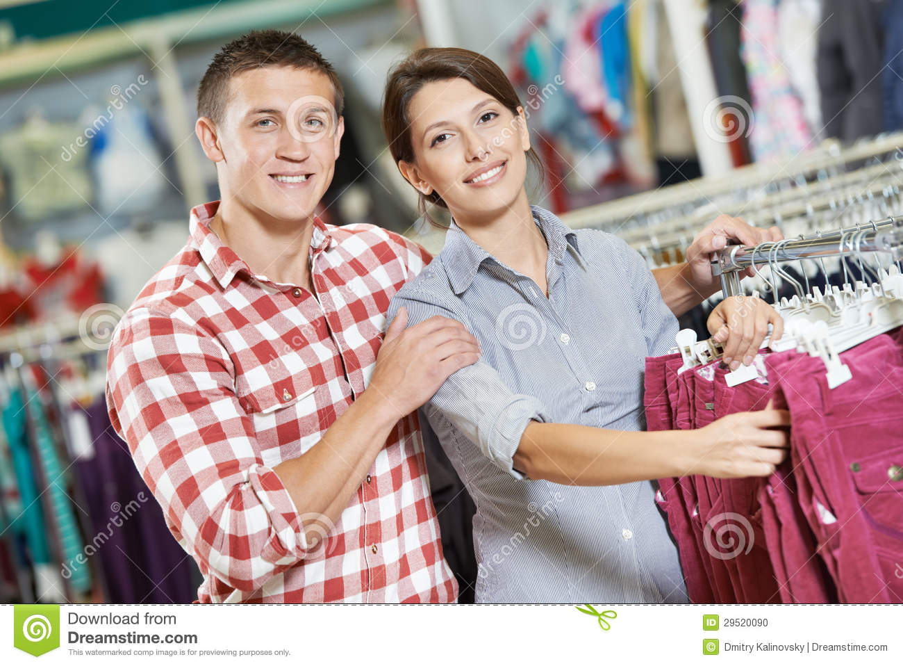 Stock Photo: Young family at clothes shopping store