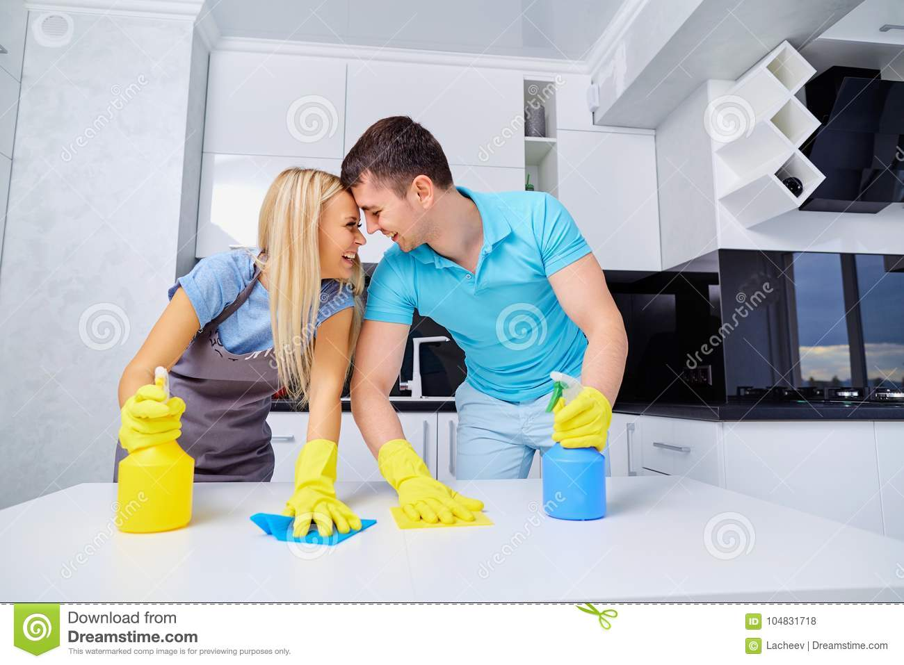 Young Family Couple Doing Cleaning In The House. Stock Photo - Image ...