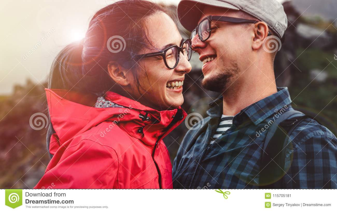 Young Couple Hikers Laugh And Enjoy Vacation
