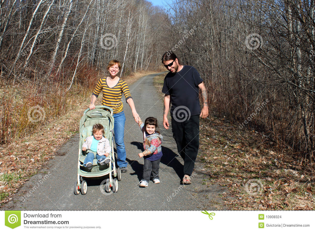 young family going for a walk stock images