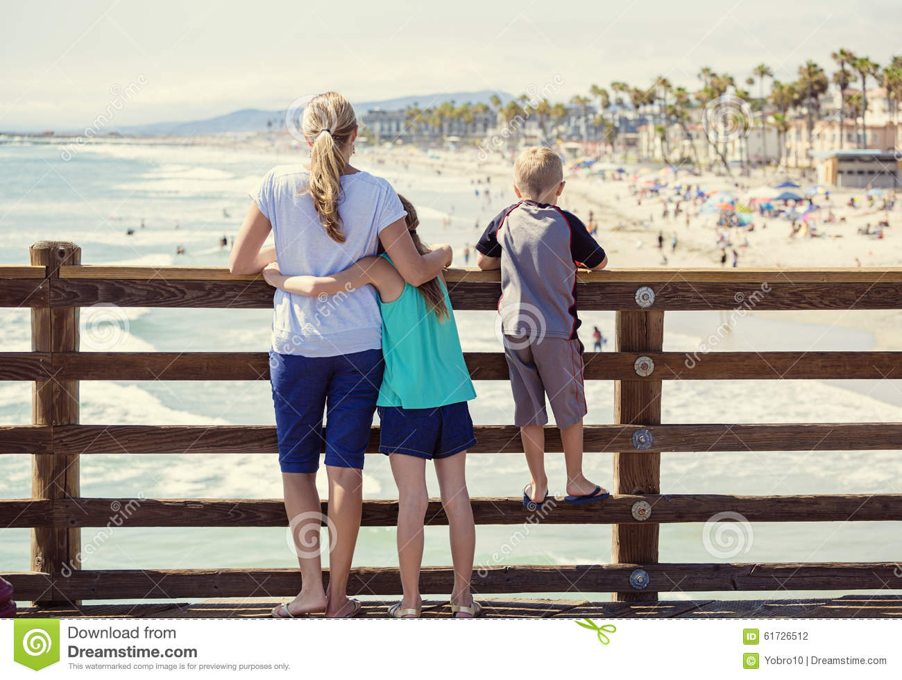 young family hanging out on an ocean pier on vacation. Black Bedroom Furniture Sets. Home Design Ideas