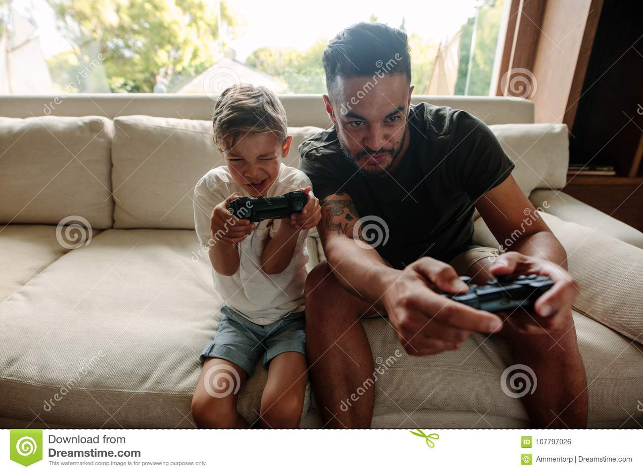 Young family having fun playing video games at home