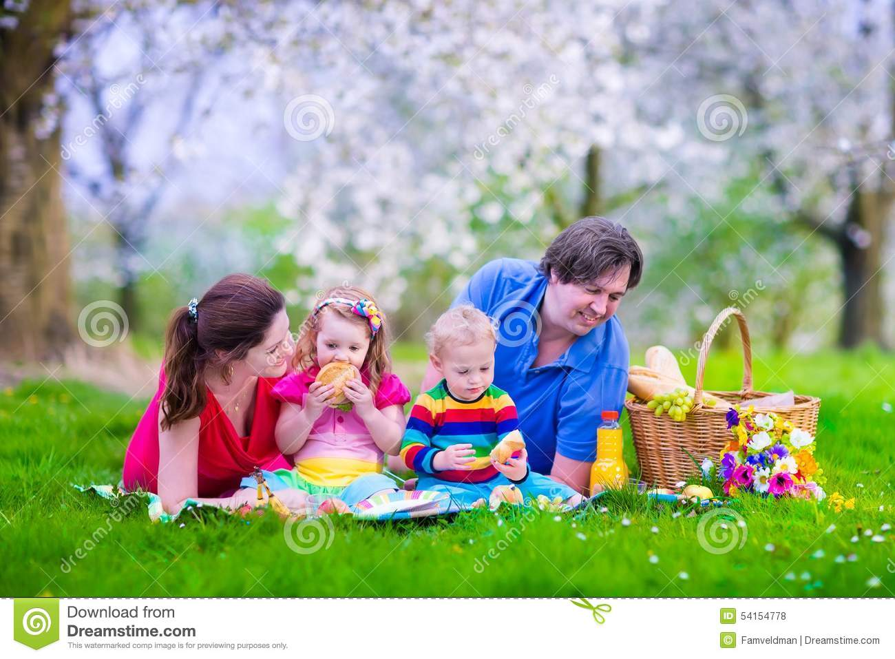 young family with kids having picnic outdoors stock photo Picnic Time Clip Art Family Picnic Day Clip Art
