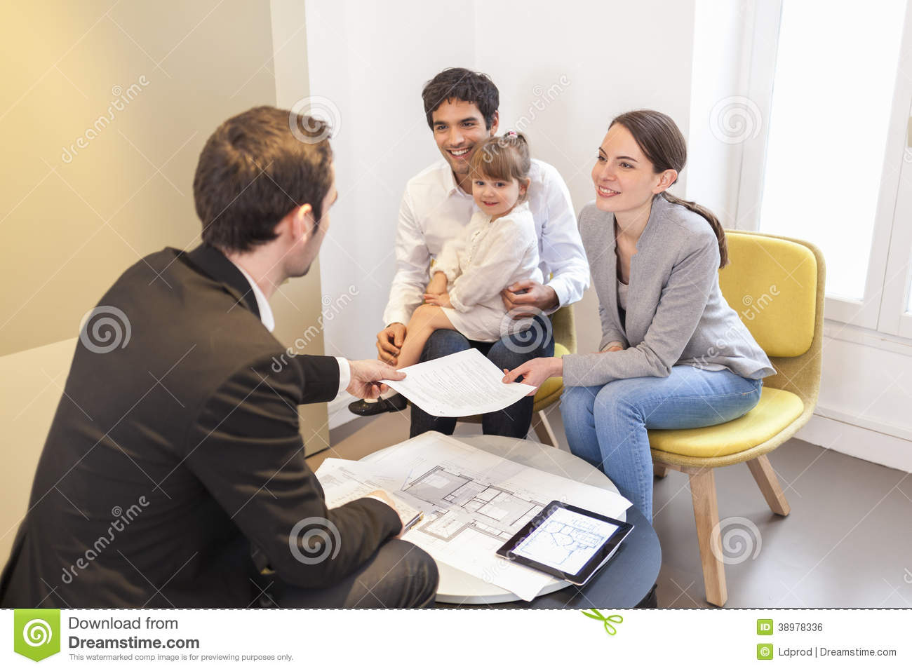 Young Family Meeting Real-Estate Agent To Buy Property -2084