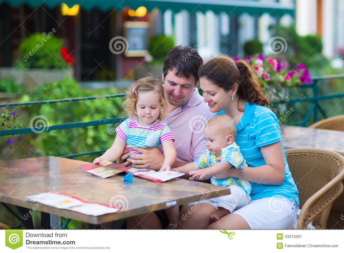 Family Cafe With Green Walls Stock Photo
