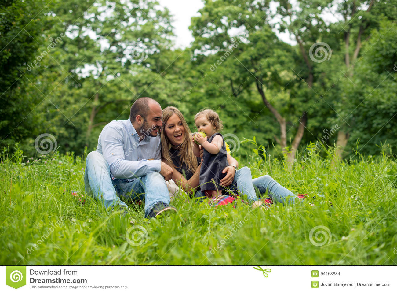Young family playing in nature