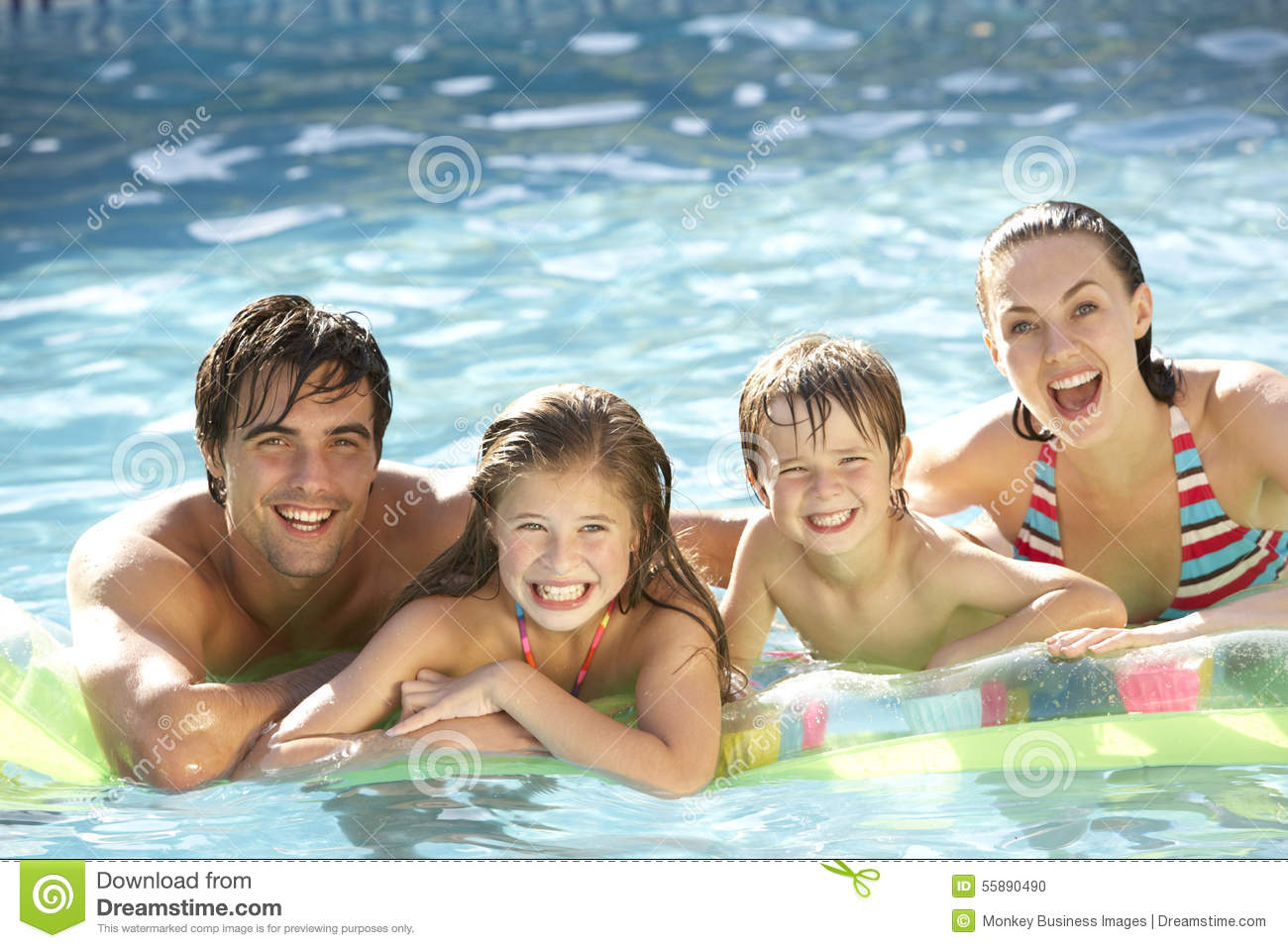 Young family relaxing in swimming pool stock photo image for Family swimming pool