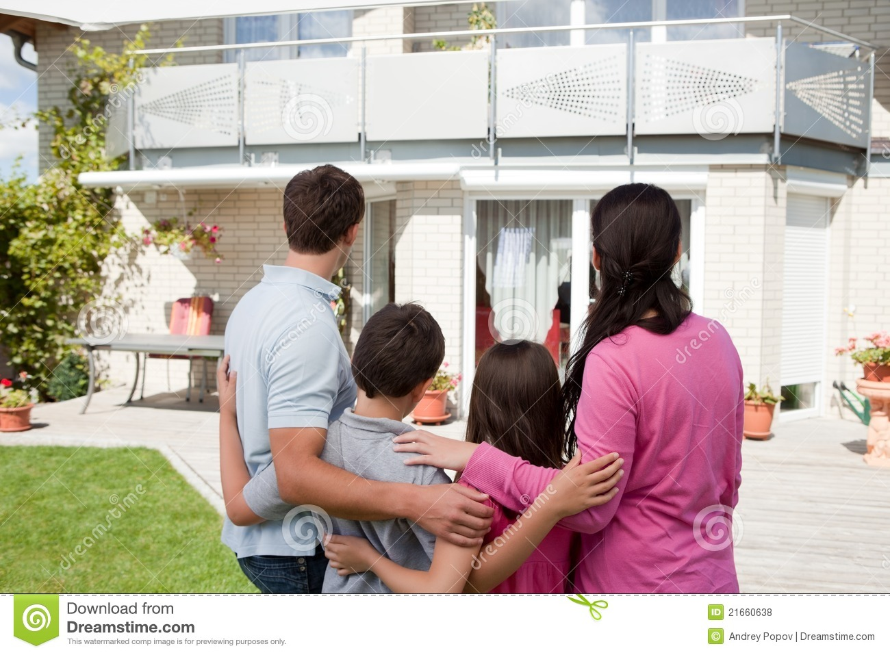 Young Family Standing In Front Of Their Dream Home Stock