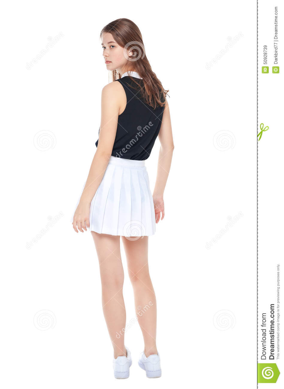 Very Young Fashion Girl In White Skirt Posing Isolated. Back Stock  AG39