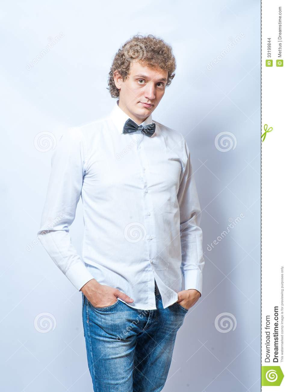 Young Fashion Male Model Wearing Bow Tie On Gray Stock