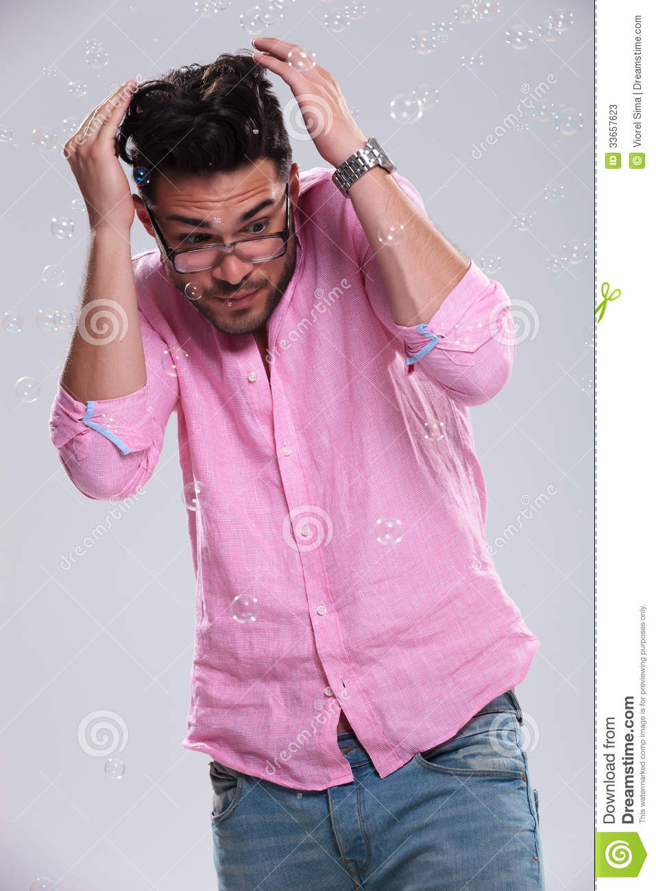 Young Fashion Man Ducking From Bubbles Stock Photos