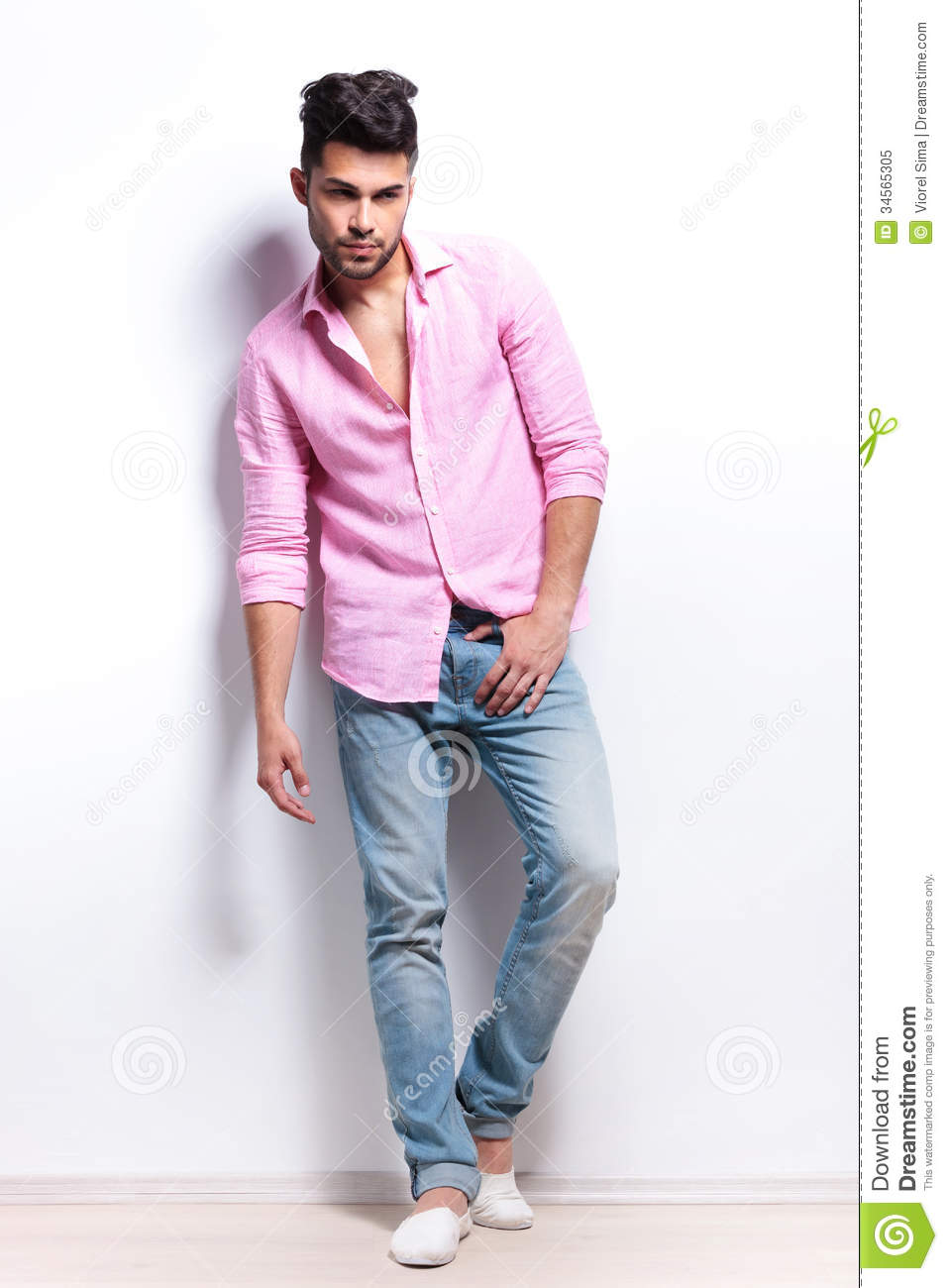 Young Fashion Man Holds Hand At Crotch Royalty Free Stock
