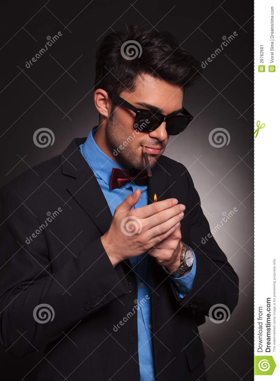 Young Fashion Man Lighting His Cigarette Stock Image - Image of copy, habit: 28782681