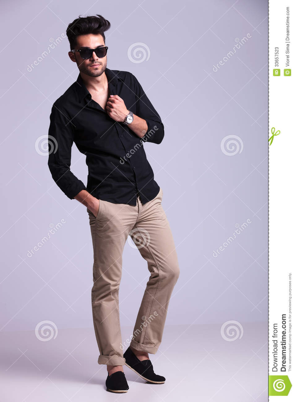 Young Fashion Man With Hand In Shirt Stock Photography