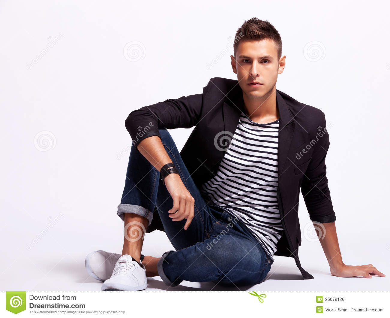 Young Fashion Man Sitting Relaxed Stock Photo Image
