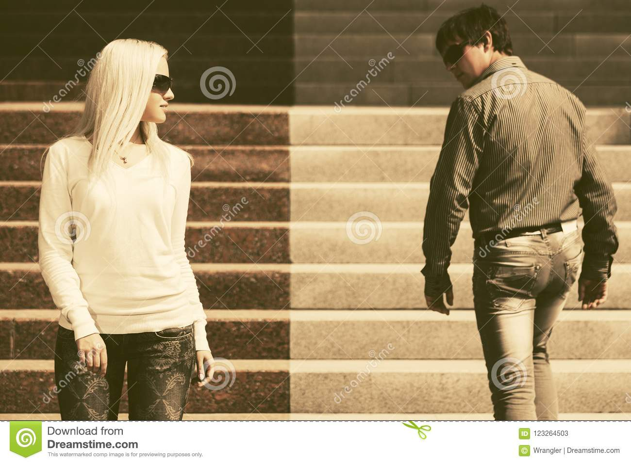 Young Fashion Man And Woman Flirting In City Street Stock
