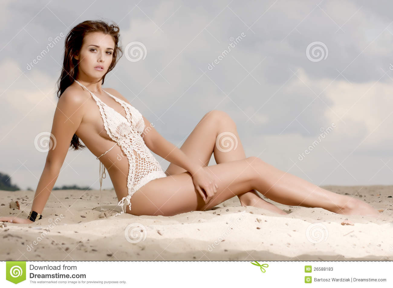 Young fashion pretty woman on the beach