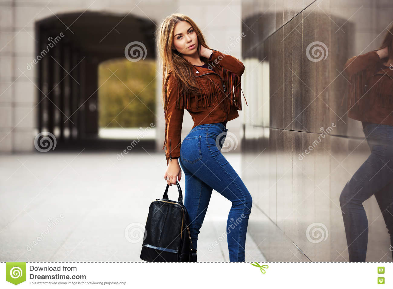 Young fashion woman in leather jacket with handbag