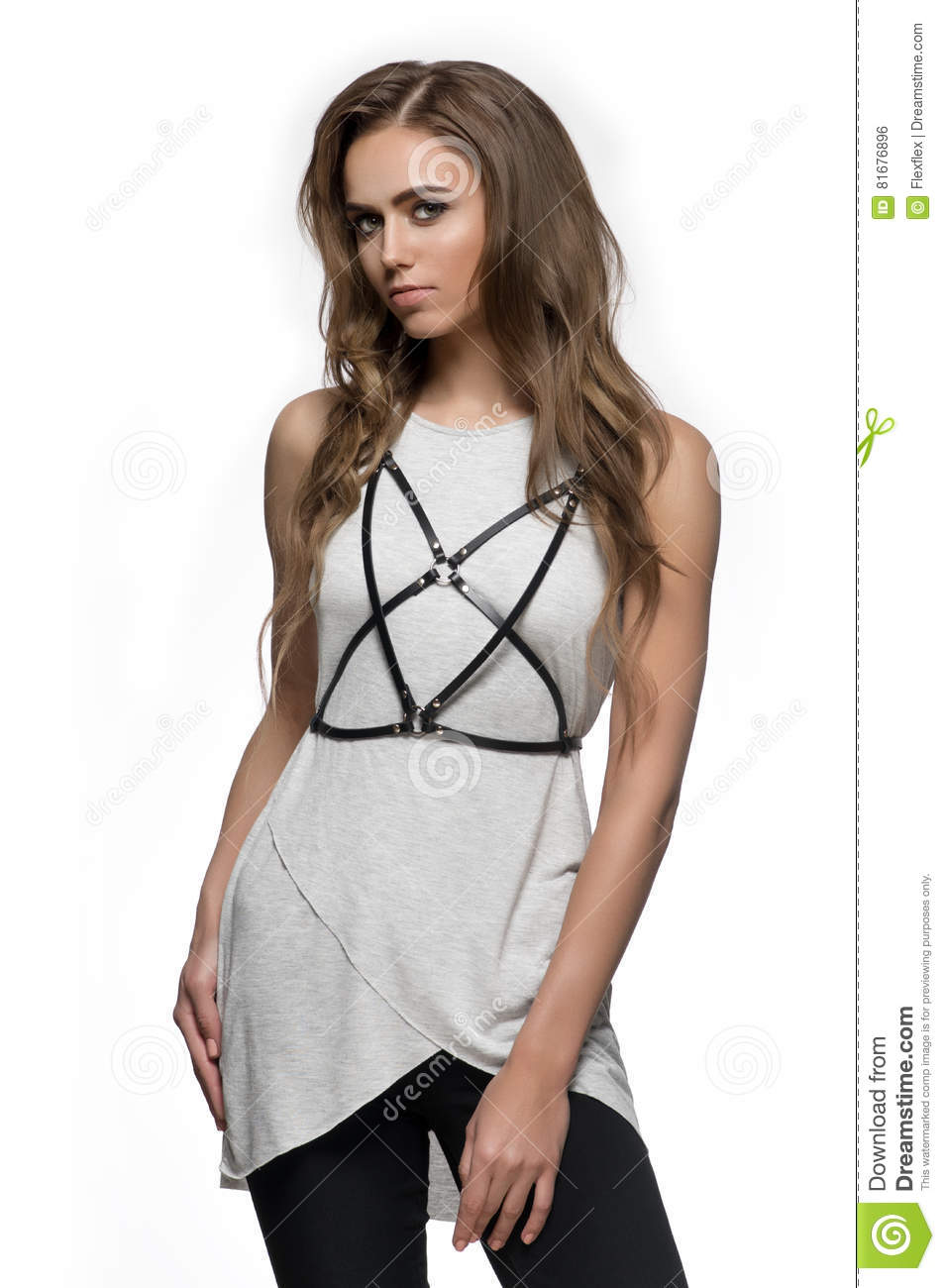 Young fashion woman posing in leather harness