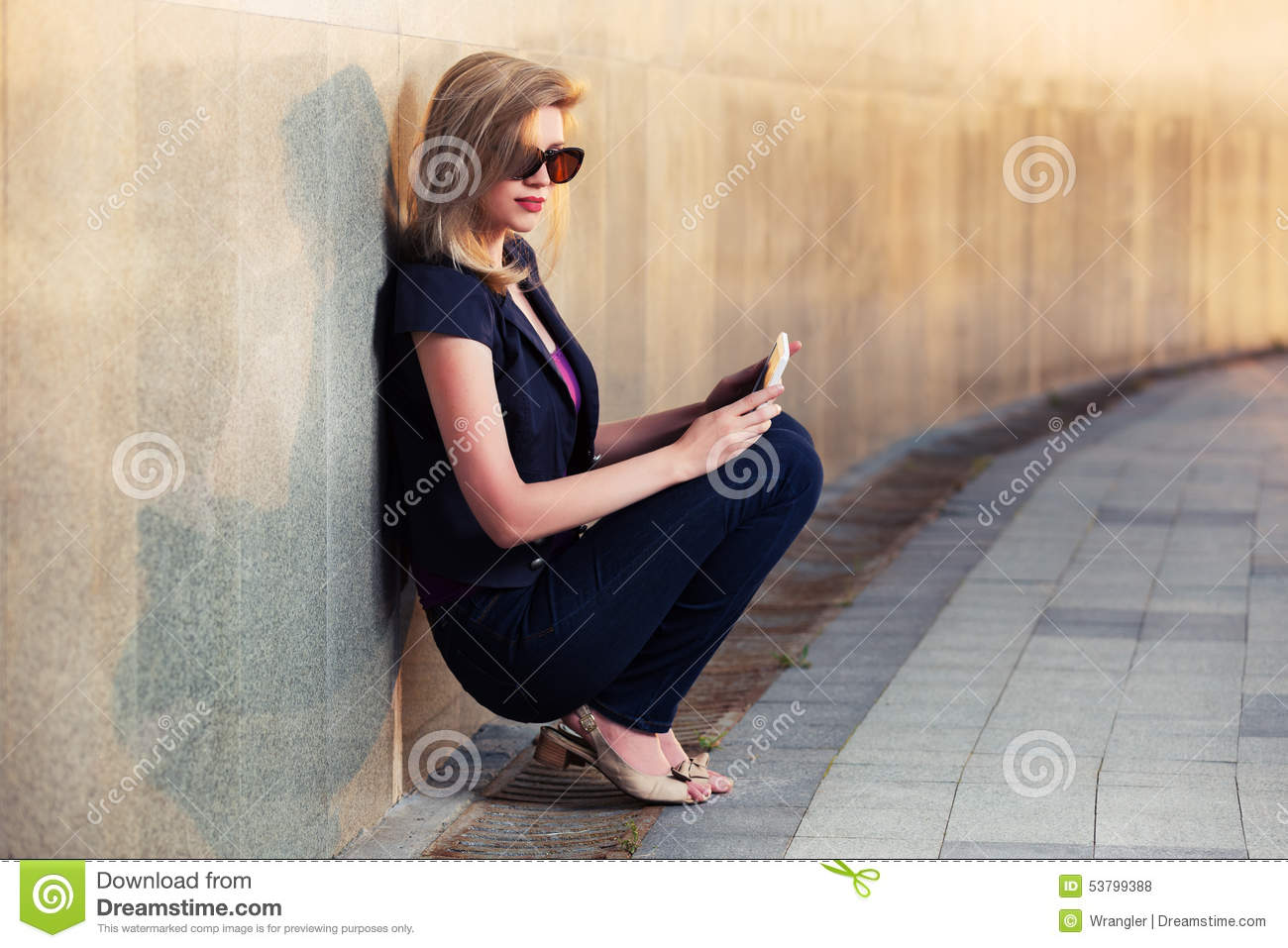 Happy Young Fashion Woman At The Wall Stock Photography 56954096