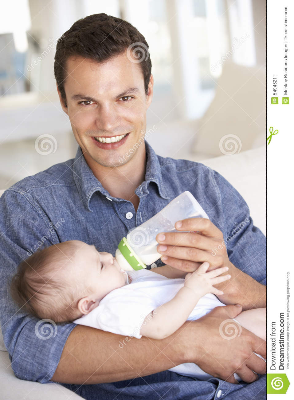 Portrait Of Father Feeding Newborn Baby At Home Royalty ...
