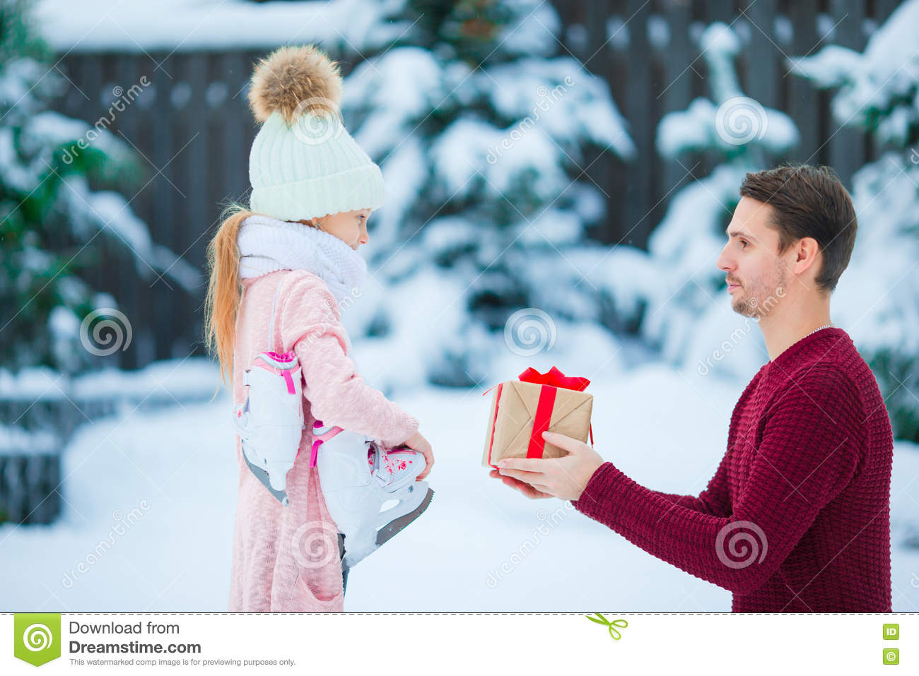 Christmas Ideas For Dad From Daughter.Young Father Gives Christmas Gift To His Little Adorable