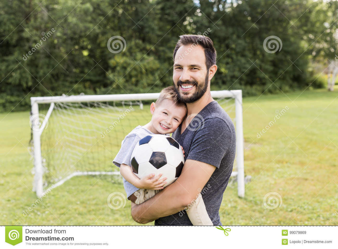 Download Young Father With His Little Son Playing Football On Football Pitch Stock Image - Image of family, love: 99079869