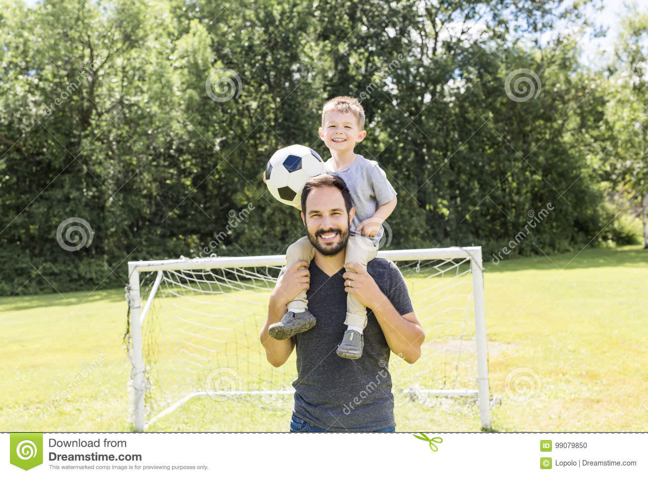 Download Young Father With His Little Son Playing Football On Football Pitch Stock Photo - Image of smile, play: 99079850