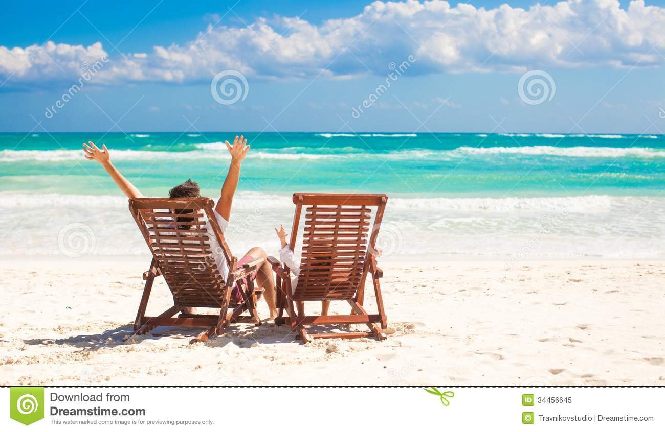 Young Father With Little Daughter In Beach Chairs Royalty Free Stock Image