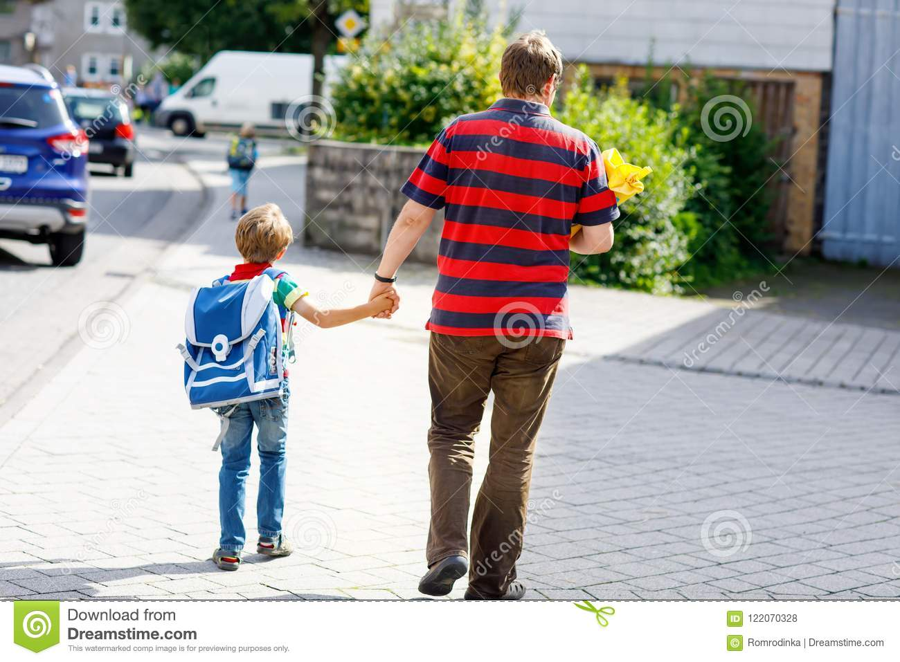 Young father taking child, kid boy to school on his first day