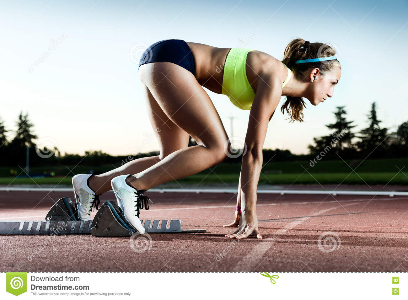 Download Young Female Athlete Launching Off The Start Line In A Race. Stock Image - Image of sport, exercising: 76368097